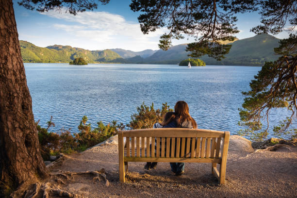 Mother and daughter enjoying view of Lake Derwentwater near Keswick, England stock photo