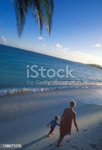 istock Mother and daughter float in tropical sea in the morning 1288271279