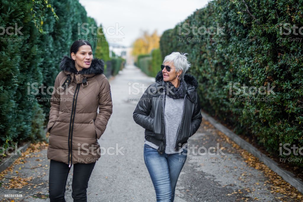 Mother and daughter going for a walk stock photo