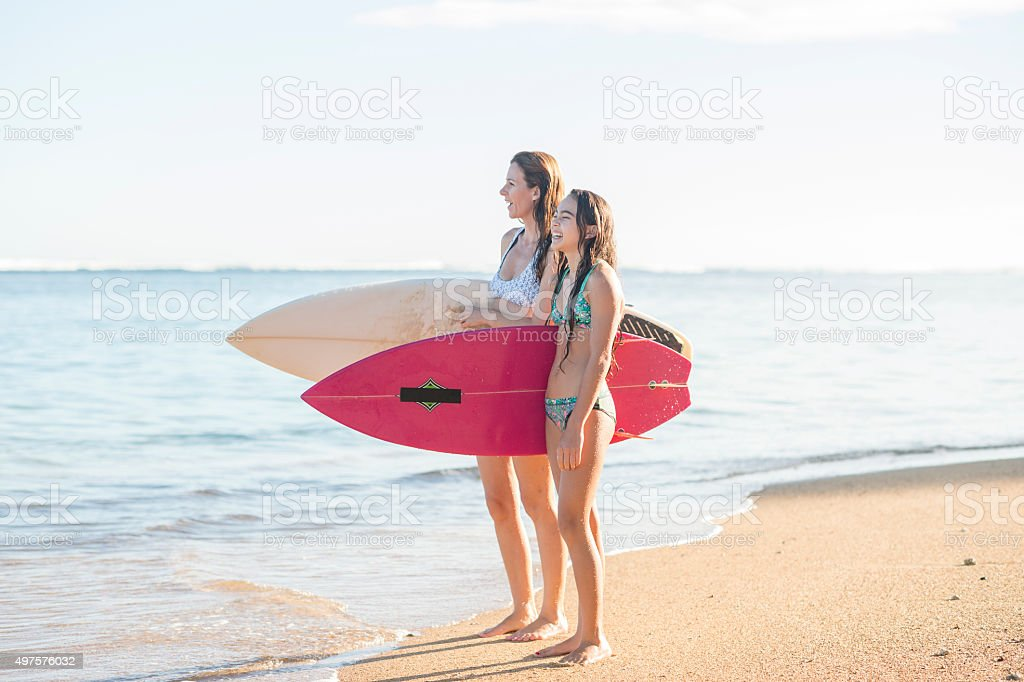 Mother and Daughter Going Surfing stock photo