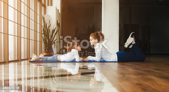 istock Mother and daughter have fun in the gym 486973218