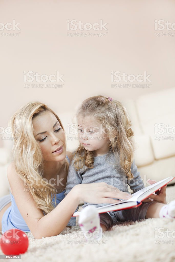 Mother and daughter have fun with story royalty-free stock photo