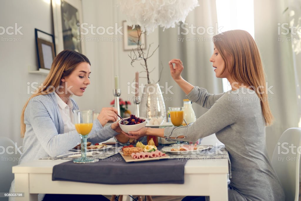Mother and daughter having a conversation stock photo