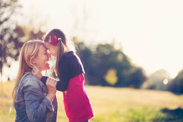 mother and daughter having a great time in nature - mothers day stock pictures, royalty-free photos & images