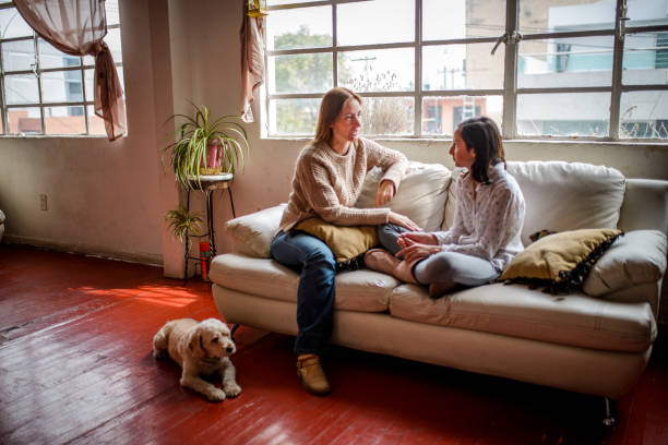 Mother and daughter having a talk. stock photo