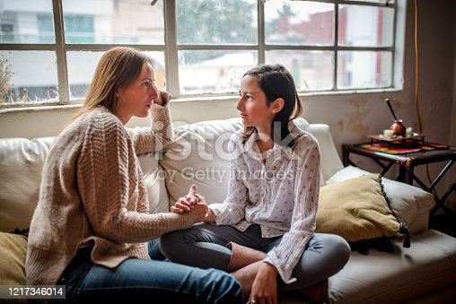 Mother and daughter at home having a  talk at home
