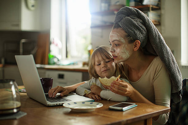 mother and daughter having breakfast - busy stock photos and pictures