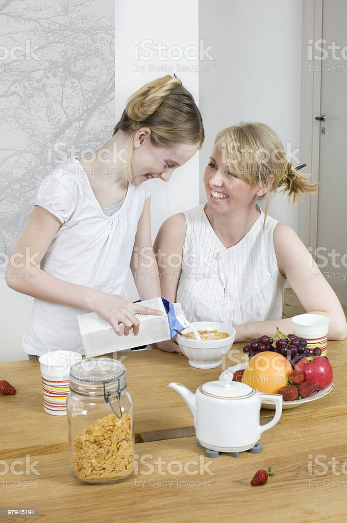 Mother and daughter having breakfast royalty-free stock photo