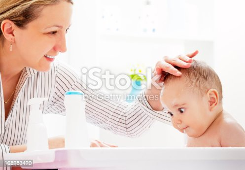 istock Mother and Daughter Having Fun in Baby Bath 168253420