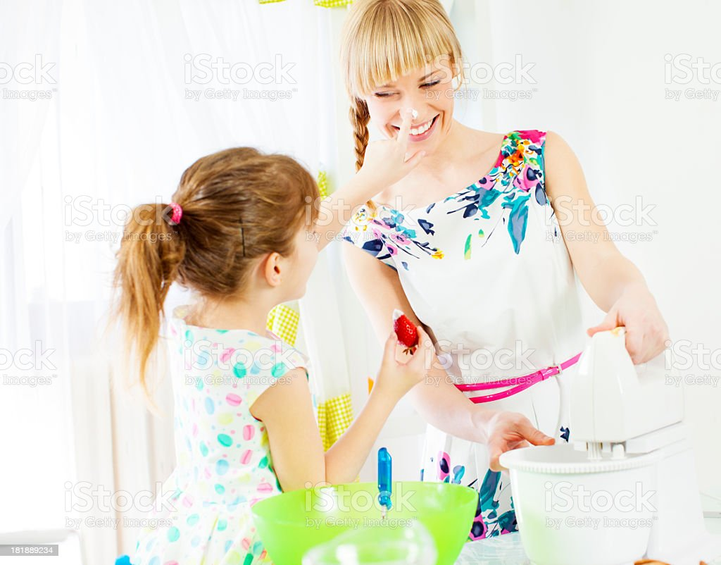 Mother and daughter having fun in kitchen royalty-free stock photo