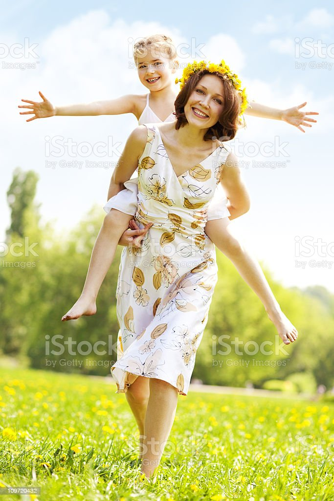 Mother and daughter having fun in park royalty-free stock photo