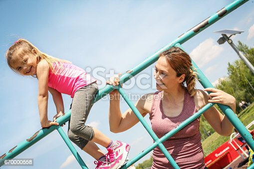 istock Mother and daughter having fun in playground. 670000558