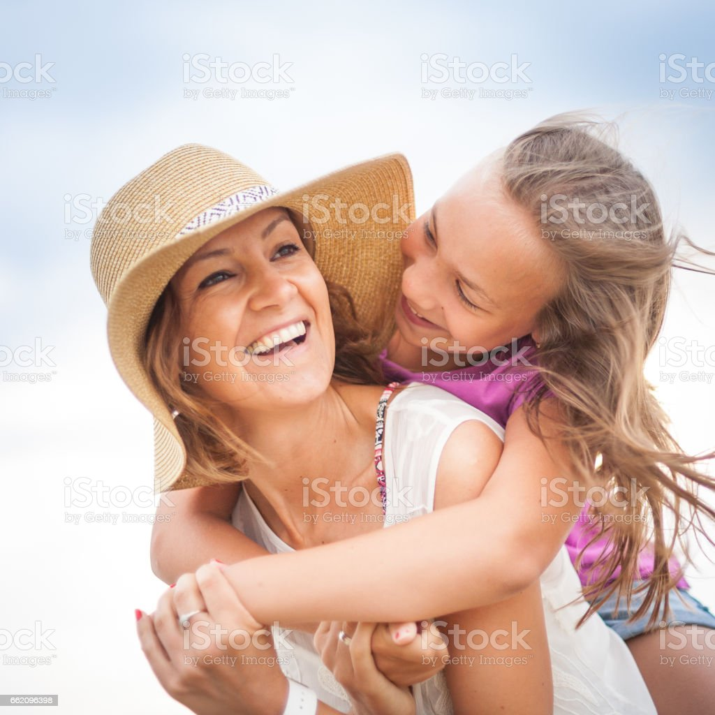 Mother and daughter having fun on the beach royalty-free stock photo