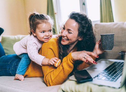 istock Mother and daughter Having fun online 1097590474