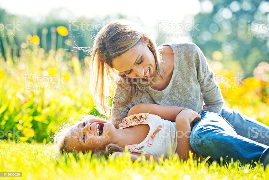 Mother and daughter having fun outdoors stock photo