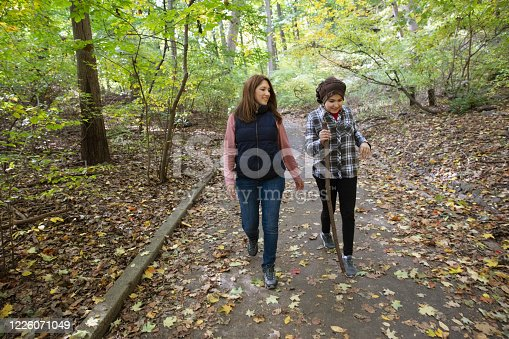 Mother and daughter hiking outside in nature