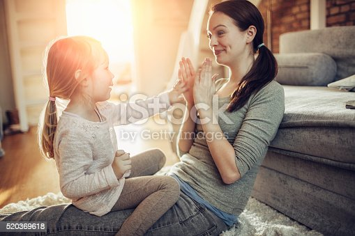 istock Mother and daughter having fun 520369618