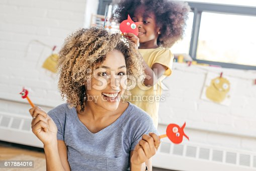 istock Mother and daughter having fun 617884016