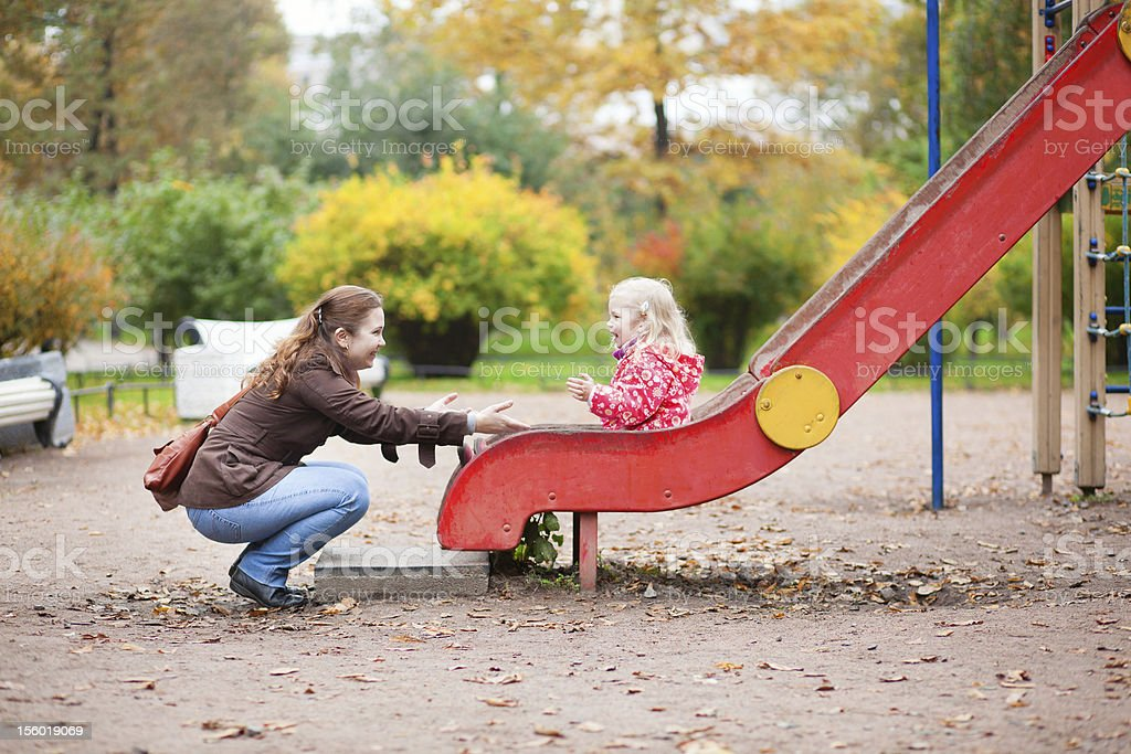 Mother and daughter having fun together on playground royalty-free stock photo