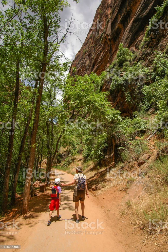 Mother and daughter hike stock photo