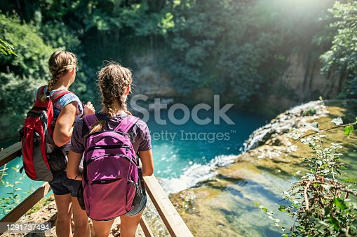 Mother and daughter hiking near river Elsa in Colle di Val d'Elsa, Tuscany. Nikon D850