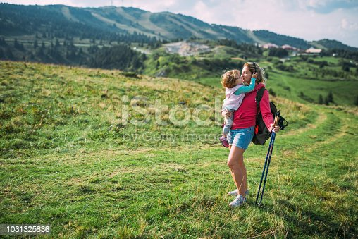 Hiking and relaxation in mountains in summer time. Healthy lifestyle concept and back to nature