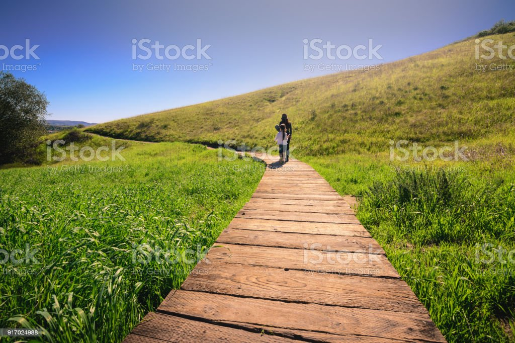 Mother and daughter hiking on footpath in Orange Country, CA stock photo