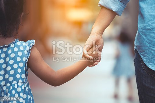 Mother and daughter holding hand together with love in vintage color tone