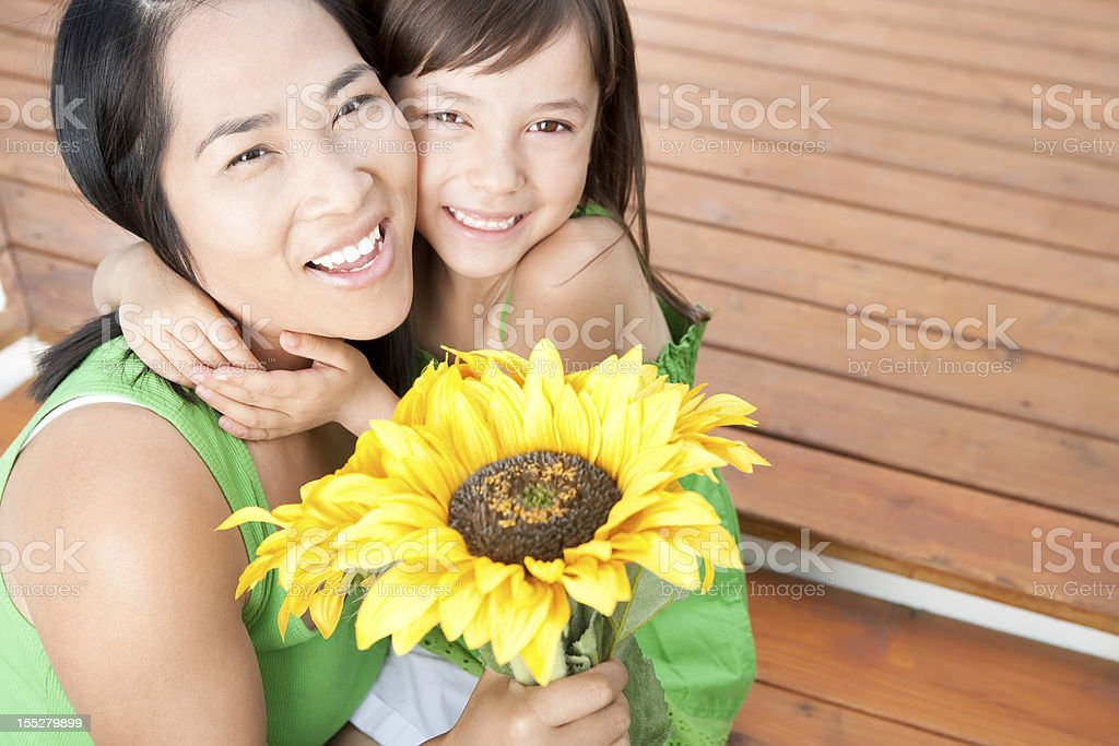 Mother and Daughter holding sunflowers royalty-free stock photo