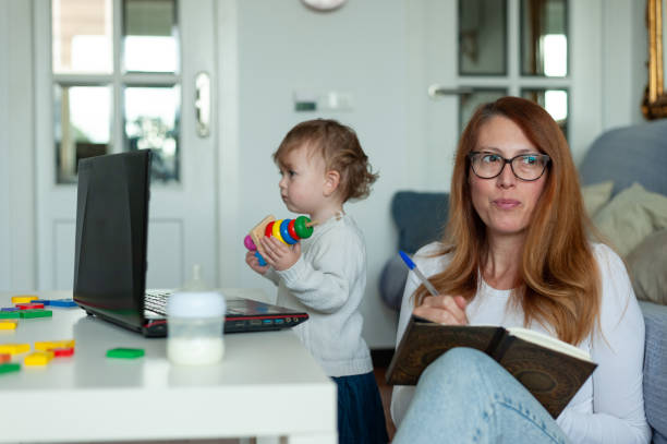 Mother and daughter home office. Lockdown concept. stock photo