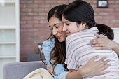 istock Mother and daughter hug affectionately 1163991991