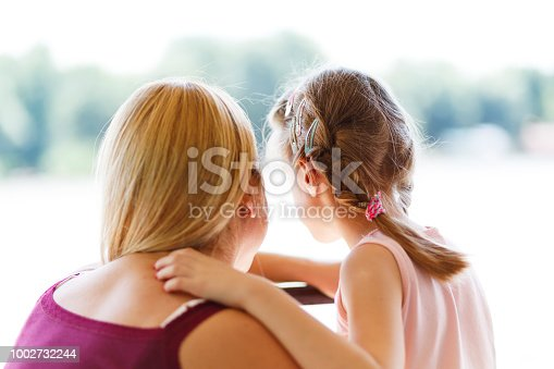 466231012istockphoto Mother and daughter hugging outdoors 1002732244