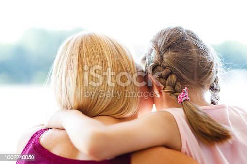 466231012istockphoto Mother and daughter hugging 1002240050