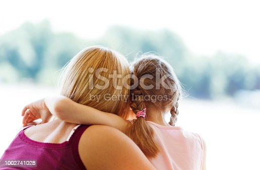466231012istockphoto Mother and daughter hugging 1002741028
