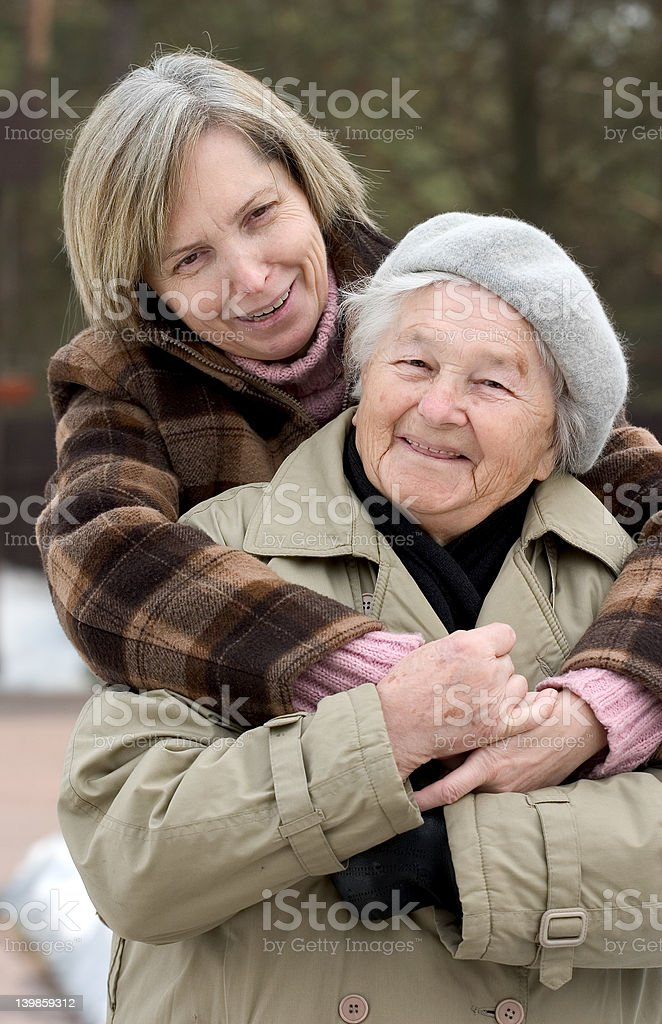 Mother and daughter hugging royalty-free stock photo