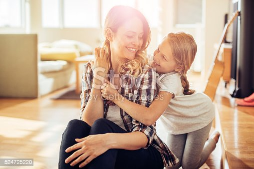 istock Mother and daughter hugging 524725220