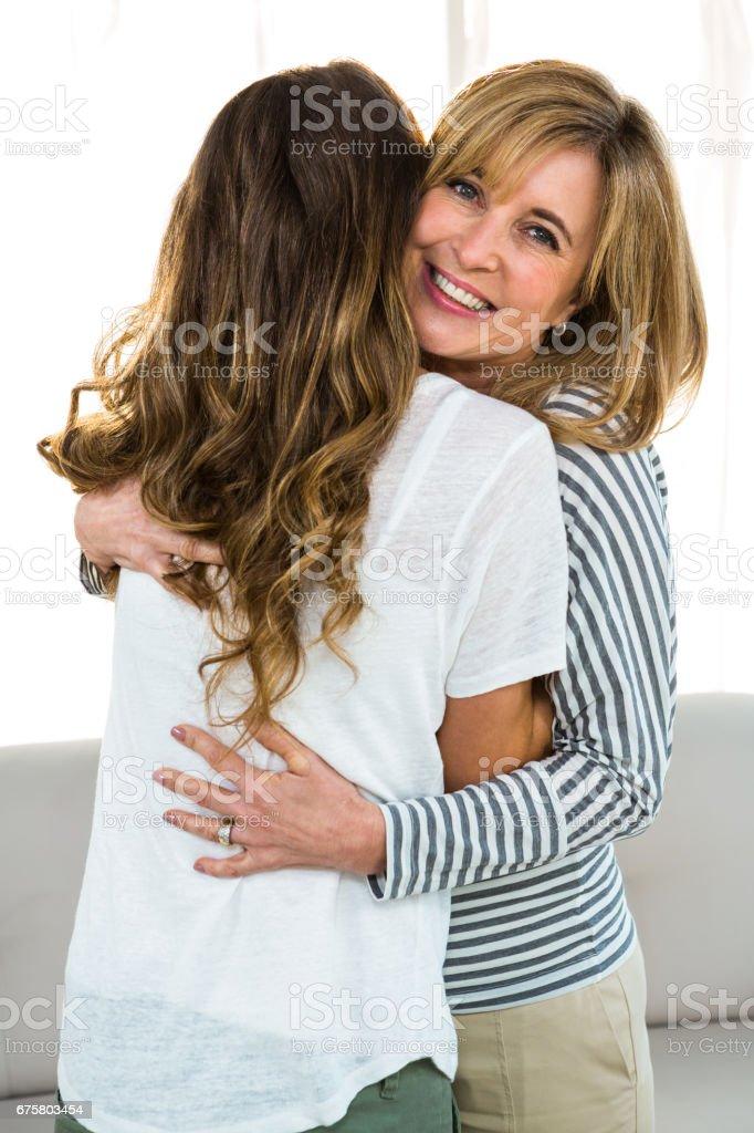 Loving Daughter Hug Mother People Posing Looking At Camera