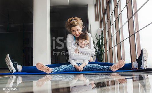 istock Mother and daughter hugs and stretch in the gym 467733456