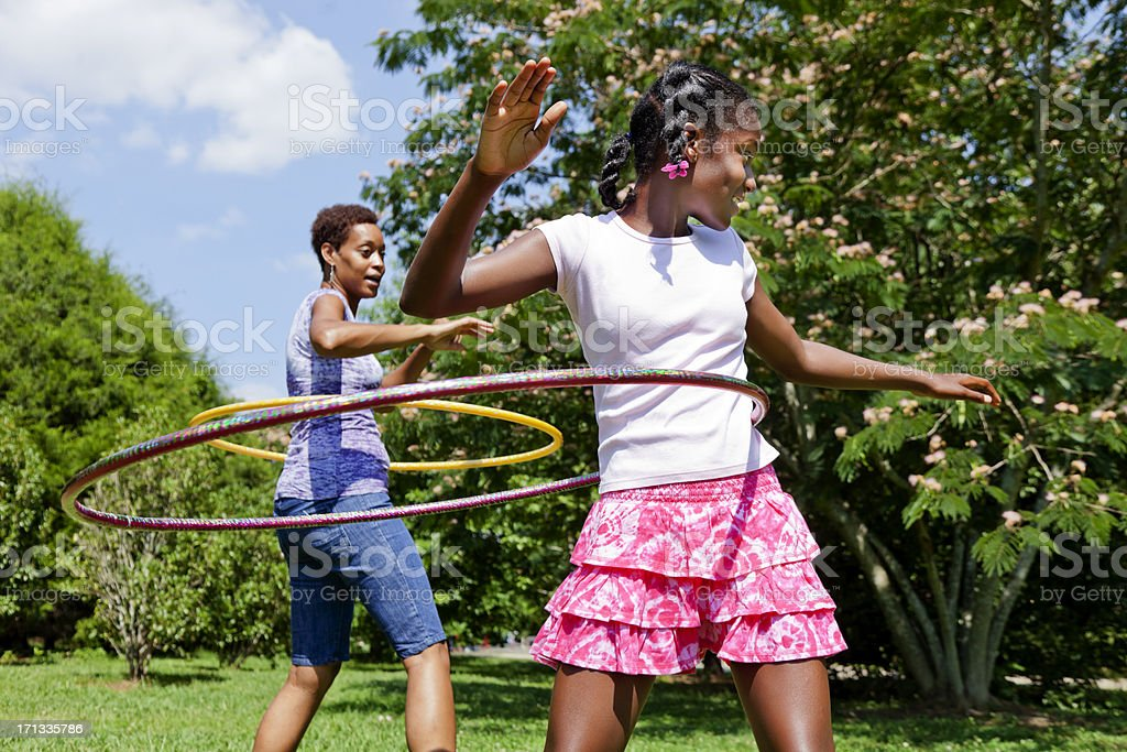 Mother and Daughter Hula Hooping royalty-free stock photo