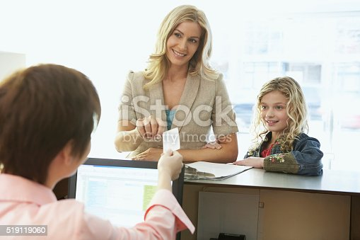 istock Mother and daughter in a medical office 519119060