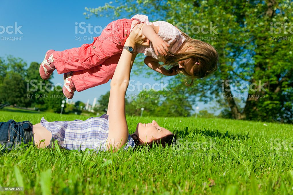 mother and daughter in a park royalty-free stock photo