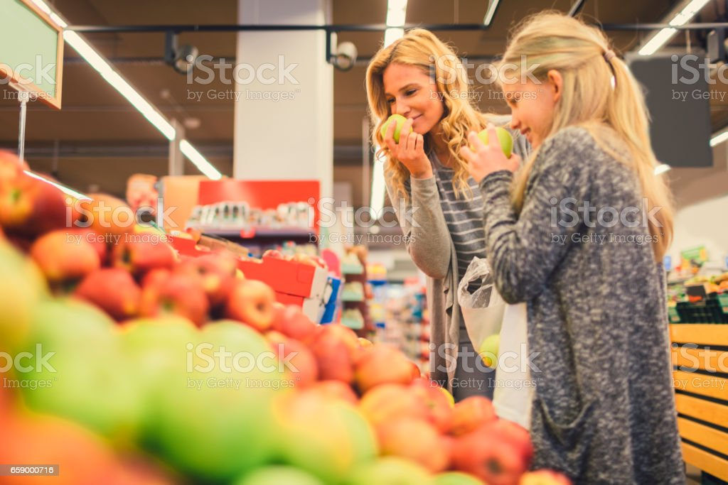 Mother and Daughter In A Supermarket royalty-free stock photo
