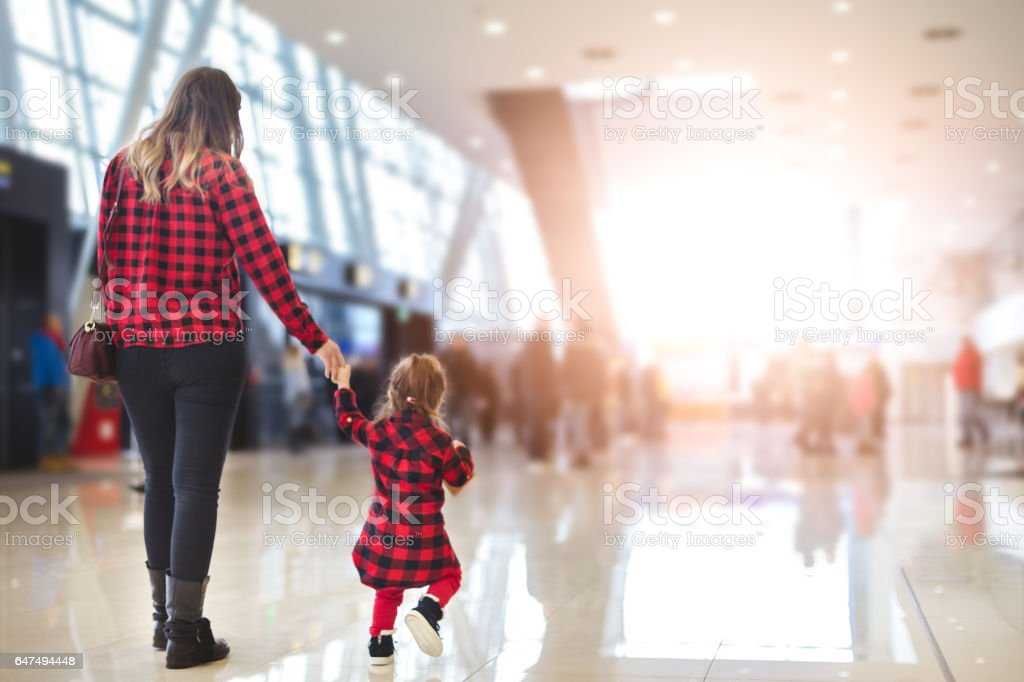Mother and daughter in airport stock photo