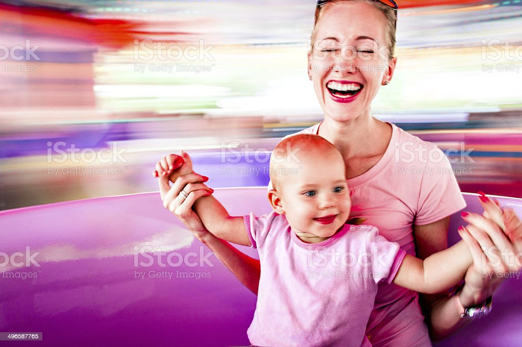 Mother and daughter in amusement park stock photo