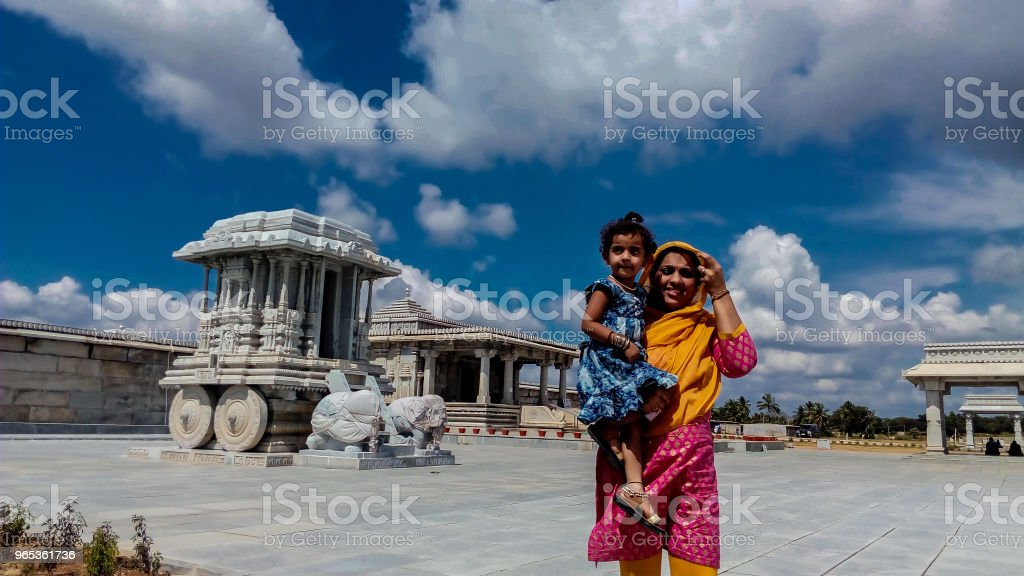 mother and daughter in front of temple royalty-free stock photo