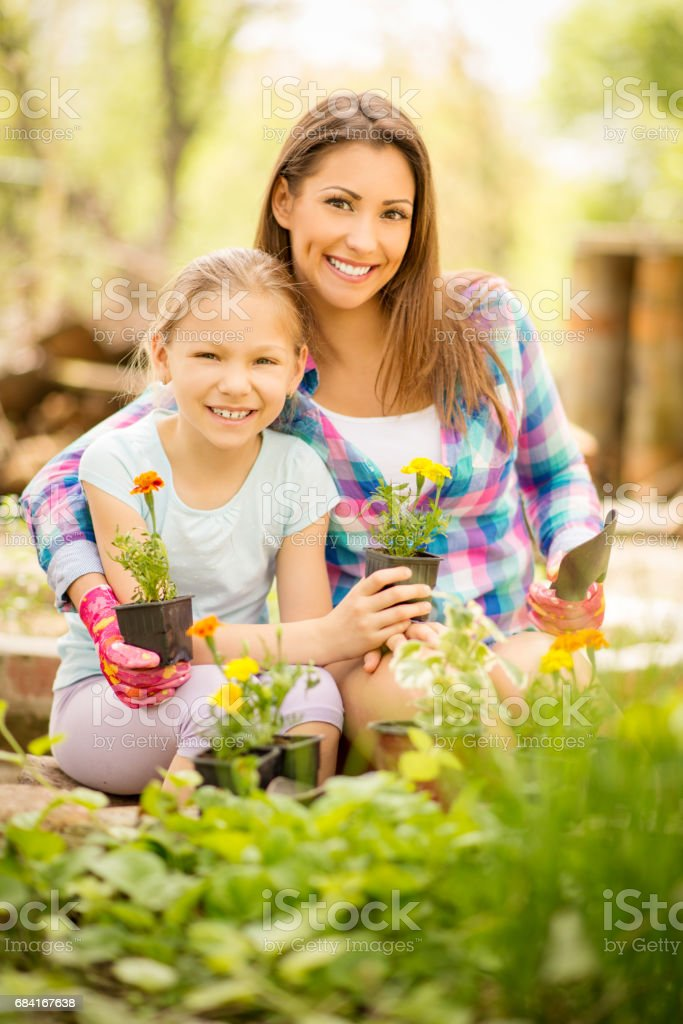 Mother And Daughter In Garden royalty-free stock photo