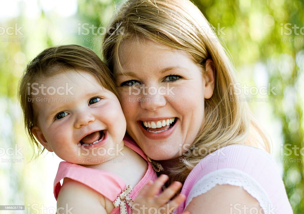 Mother and daughter in golden light stock photo