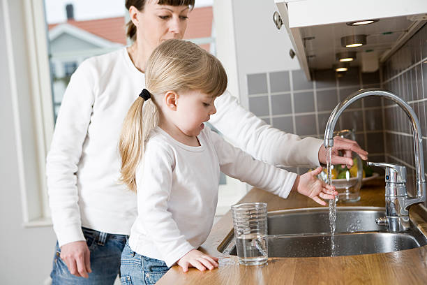 Mother and Daughter in kitchen stock photo
