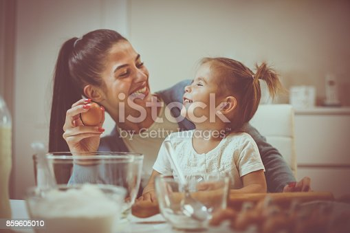 1063760138 istock photo Mother and daughter in kitchen. 859605010