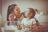 istock Mother and daughter in kitchen. 859605010